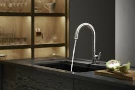 bathroom design charming kohler faucets for bathroom or kitchen interesting silver stainless steel kohler faucets with curved neck and single handle on dark countertop with