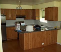 limestone countertops brown painted kitchen cabinets lighting