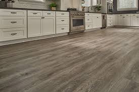 white kitchen cabinets with vinyl plank flooring what you need to about vinyl plank flooring empire