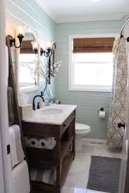 best images about main bathroom ideas pinterest white pretty airy and tranquil guest bathroom renovation featuring white marble floors wood paneled walls painted benjamin moore palladian blue via