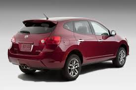 red nissan rogue sporty