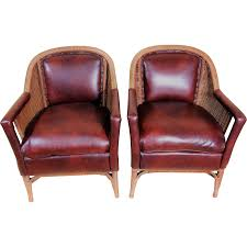 pair of heywood wakefield leather and wicker club chairs antique