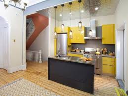 small kitchen with island layout like tall cabinets for top of