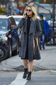 dianna agron wraps up warm in grey plaid coat while strolling in