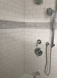 bathroom bathroom shower with daltile subway tile walls and white