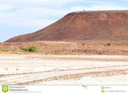 pink salt lake along the mountains outback south australia stock