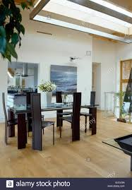 Tall Back Chairs by Tall Back Chairs At Glass Table In Modern Dining Room With Pale