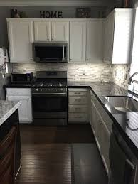Backsplashes For White Kitchens by Black Granite With A Gray Stone Backsplash For The Home