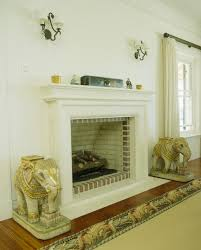 pair of elephant statues on hearth photos design ideas remodel