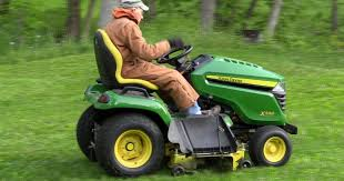2015 x590 john deere lawn tractor cutting and mowing grass youtube