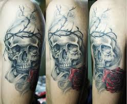 skull entwined with crown of thorns skull tattoos