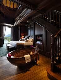 fashionable round black stone bathtub with fantastic small vanity