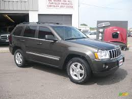 wrecked black jeep grand cherokee 2006 dark khaki pearl jeep grand cherokee limited 4x4 9696194
