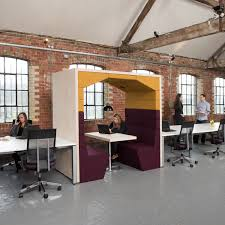 appealing office furniture pods with brick walls and vinyl