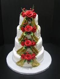 lovely three layered square wedding cake with cute rose ribbon for