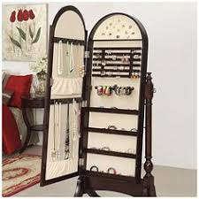 standing mirror jewelry cabinet gold silver safekeeper mirrored jewelry cabinet by lori greiner
