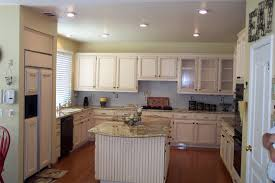cream color painting oak kitchen cabinet with marble countertop