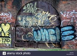 graffiti on metal doors and brick walls in dumbo brooklyn new york