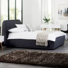 mayfair 4 drawer bed grey covered in textured grey fabric this