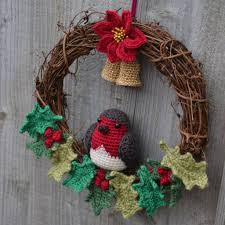 crochet christmas wreath with robin poinsettia holly and bells