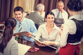 is there still a need to sit with friends and tip a waiter at