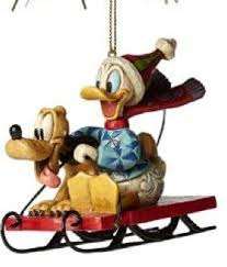donald duck pluto on snow sled ornament jim shore from our jim