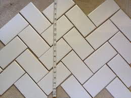 kitchen backsplash prepping for tile and selecting a pattern the height of the available tiling space limiting our ability to do a herringbone layout after laying out the tile and measuring we could see just how