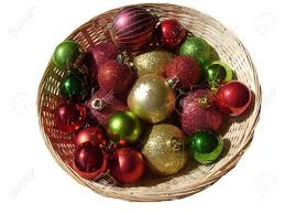 basket of gold and green tree decorations baubles