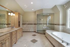 master bath with glass shower and large tub stock photo picture