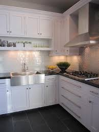 Small Kitchen Remodel Featuring Slate Tile Backsplash by White Glass Subway Tile White Cabinets Subway Tiles And