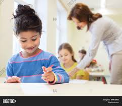 writing concept paper education elementary school and children concept happy little education elementary school and children concept happy little student girl with pen and paper