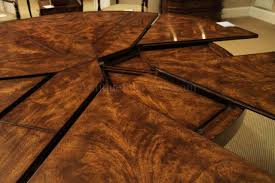 round dining room tables with self storing leaves traditional and formal mahogany jupe table with self storing leaves