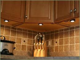 above kitchen cabinet lighting using warm white led strip lights