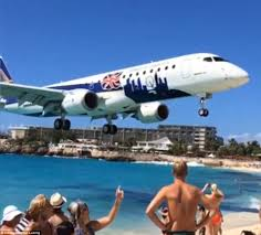tourist captures footage of plane passing just overhead of people