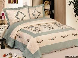 traditional bedroom concept with embroidered quilts hq home