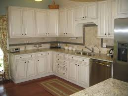 white paint wooden l shaped kitchen cabinet featuring grey granite