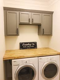 best place to buy cabinets for laundry room farmhouse laundry room installing countertop and cabinets