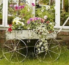 Wooden Wheelbarrow Planter by Use An Old Wheelbarrow As A Planter Home Design Garden