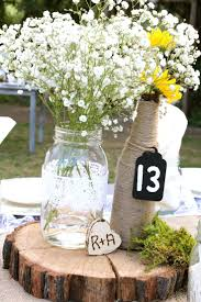jar table decorations wedding idea baby s breath in blue jars is a idea for