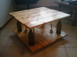 ten green coffee table from reclaimed timber and glass bottles