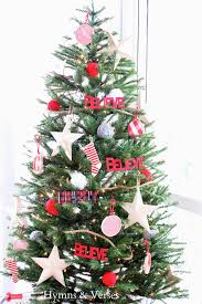 christmas on the back porch hymns and verses i decorated the tree with large wood stars that i got after christmas last year at michael s plaid and red merry and believe words from the dollar bin at