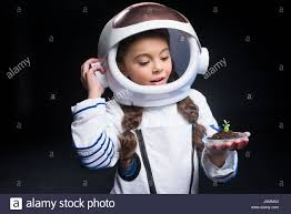 Astronaut Costume Little In Astronaut Costume And Helmet Holding Fresh Plant In