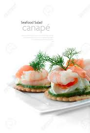 canapes with prawns delicious cheese and tiger prawn and smoked salmon