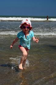 running away from waves at the bali kuta