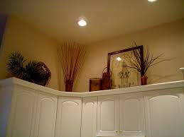 ideas for decorating above kitchen cabinets decorating above kitchen cabinets wallpaper home decor