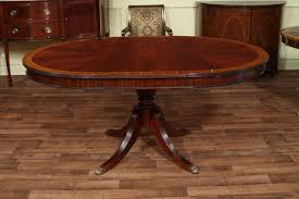 48 round dining table with leaf round mahogany dining table heirloom quality traditional mahogany dining table round to oval expands to 66