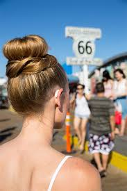 hairstyle that covers hearing aid wearer top bun with braid hearing aid hair and style show off your