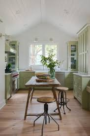 hgtv features a modern cottage kitchen with pea green shaker style