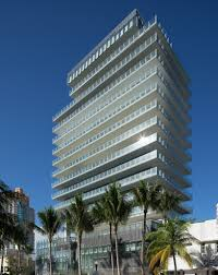 completed glass residential tower by rene gonzalez rises above