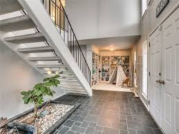 contemporary entryway with hardwood floors u0026 high ceiling in